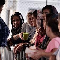 Flyktingar på ett läger på den grekiska ön Lesbos.