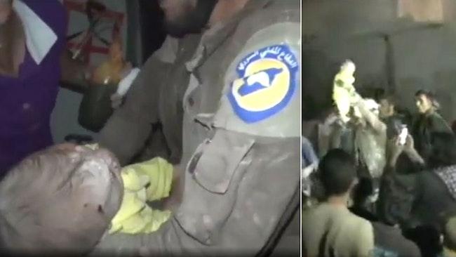 En flicka, bara en månad gammal, räddas i rasmassorna efter en bombattack i staden Idblib i Syrien.