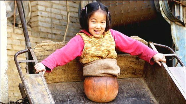 Qian Hongyan som liten flicka i basketbollen