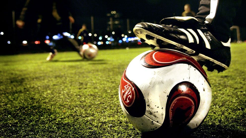 Fotbollssko på fotboll