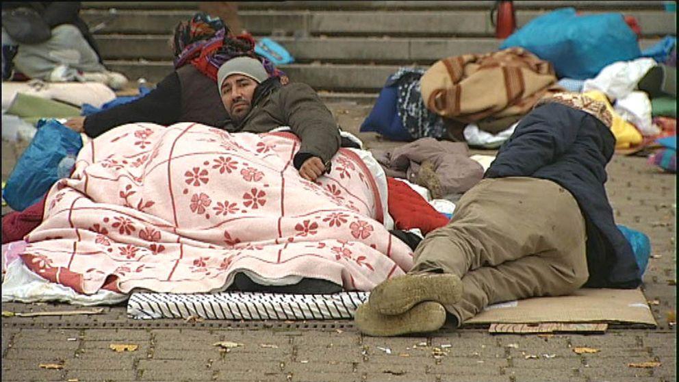 EU-migranter sov i protest utanför stadshuset i Malmö i december 2015.