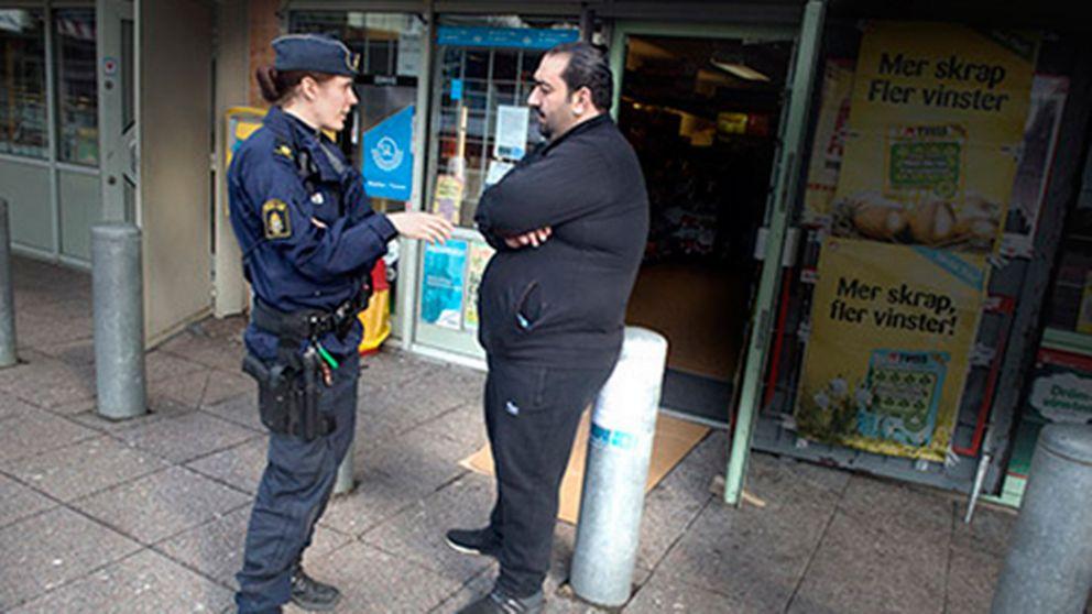 Polis och kioskägare.