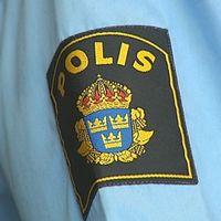 Polisemblem på arm