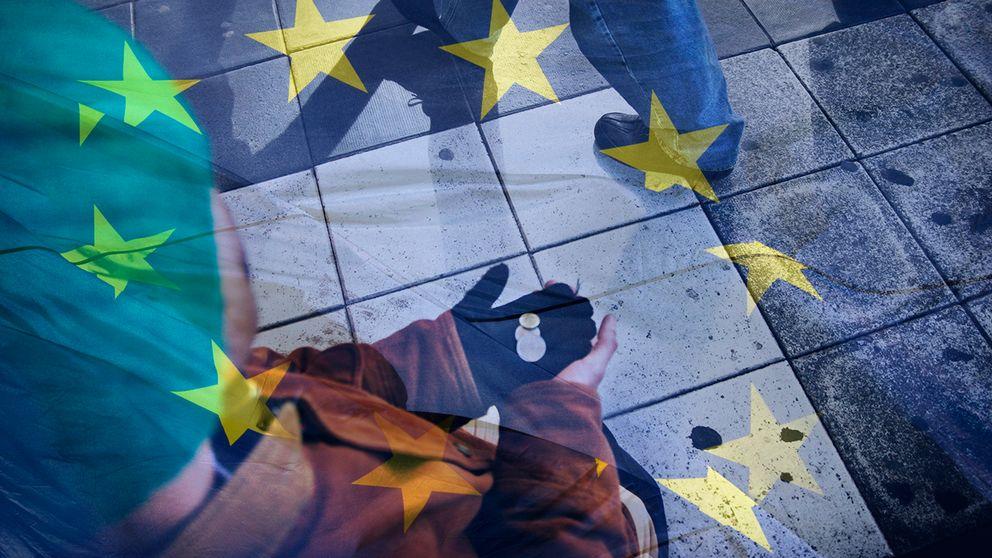 Man som tigger och EU-flagga