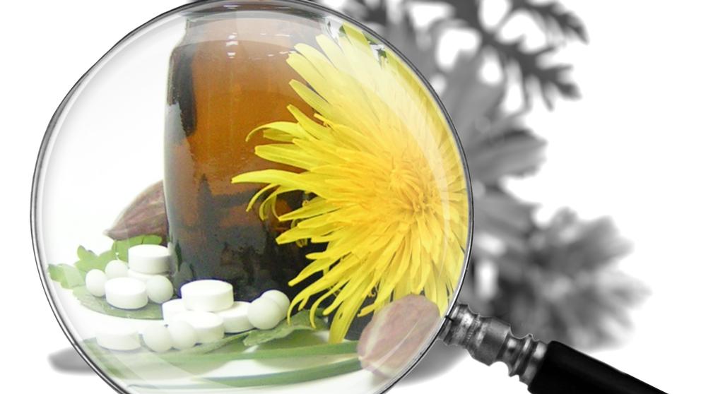 Förstoringsglas över maskros och tabletter.