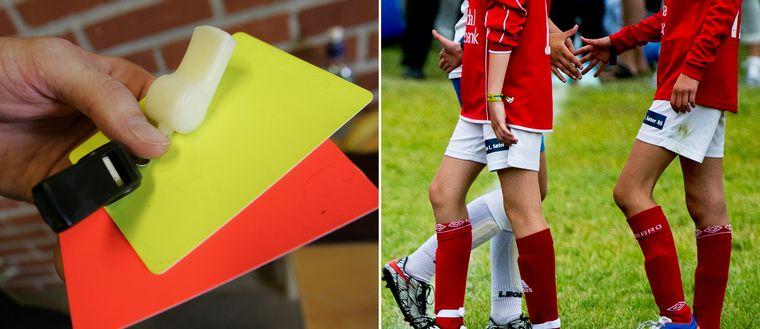 Gult och rött kort. Fotbollsspelares ben.