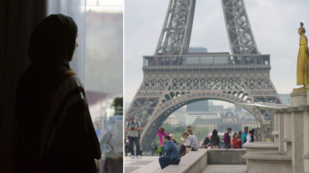 Julia som tittat ut genom ett fönster och Eifeltornet i Paris.