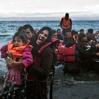 Flyktingar anländer till den grekiska ön Lesbos