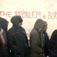 Migranter klädda i vinterkläder i Serbien.