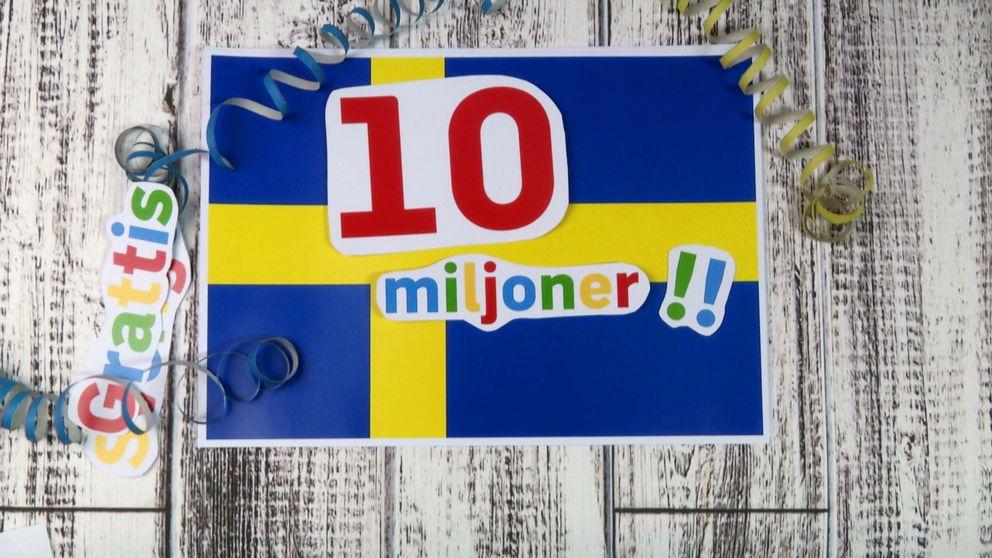 """10 miljoner"" utklippt på Sverigeflagga."