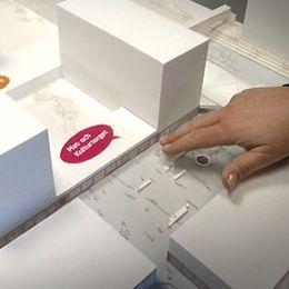 Husby centrum och en modell som visar hur centrum ska förändras med feministisk stadsplanering.