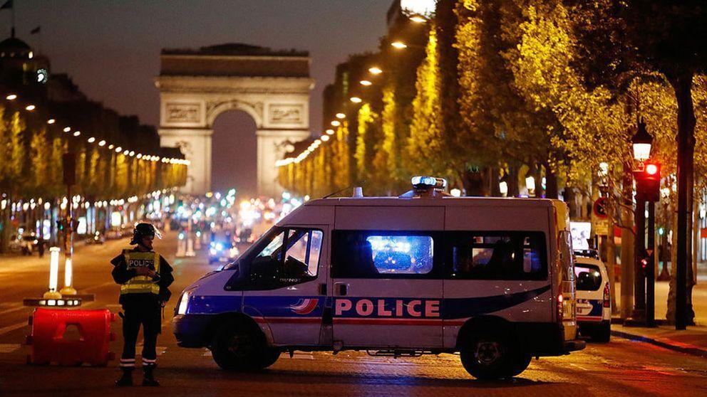 En polis ihjälskjuten på gata i Paris