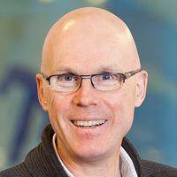 Jonas Hinnfors och bild på riksdagshuset