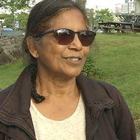 Porträtt av Anbumalar Arokianathan.