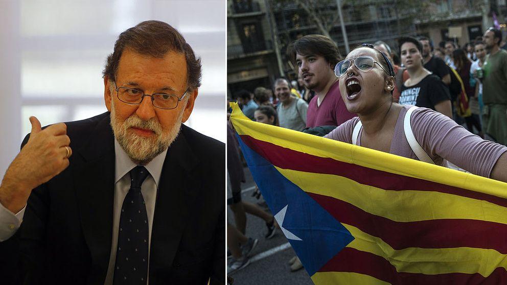 Spaniens premiärminister Mariano Rajoy och en person som håller i Kataloniens självständighetsflagga
