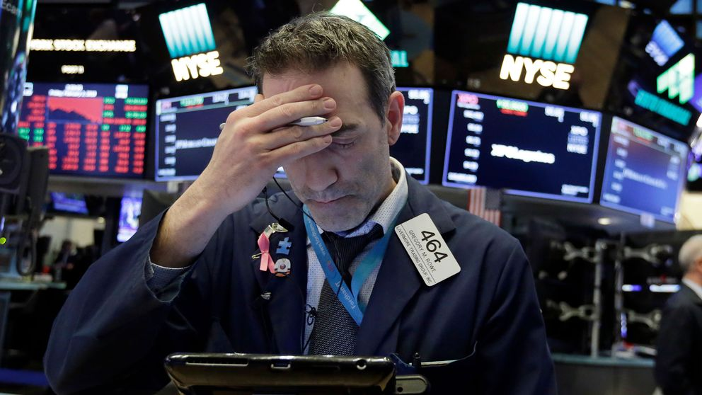 En oroad börsmäklare på Wall Street.