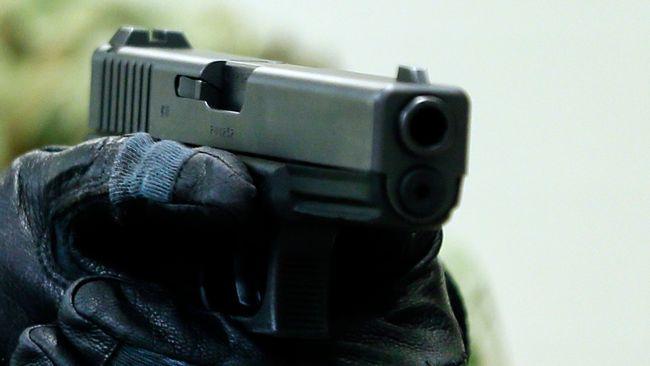 Kvinna hotade barn med pistol