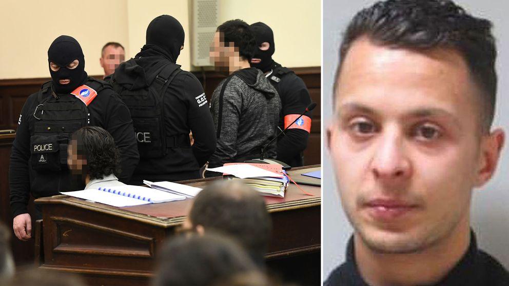 Maskerade poliser framför Salah Abdeslam i rättssalen i Bryssel.