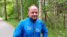 Robert Stenberg står redo för en löptur i skogen.