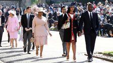Bröllopsgästerna anländer – på bild bland andra Oprah Winfrey och skådespelaren Idris Elba.