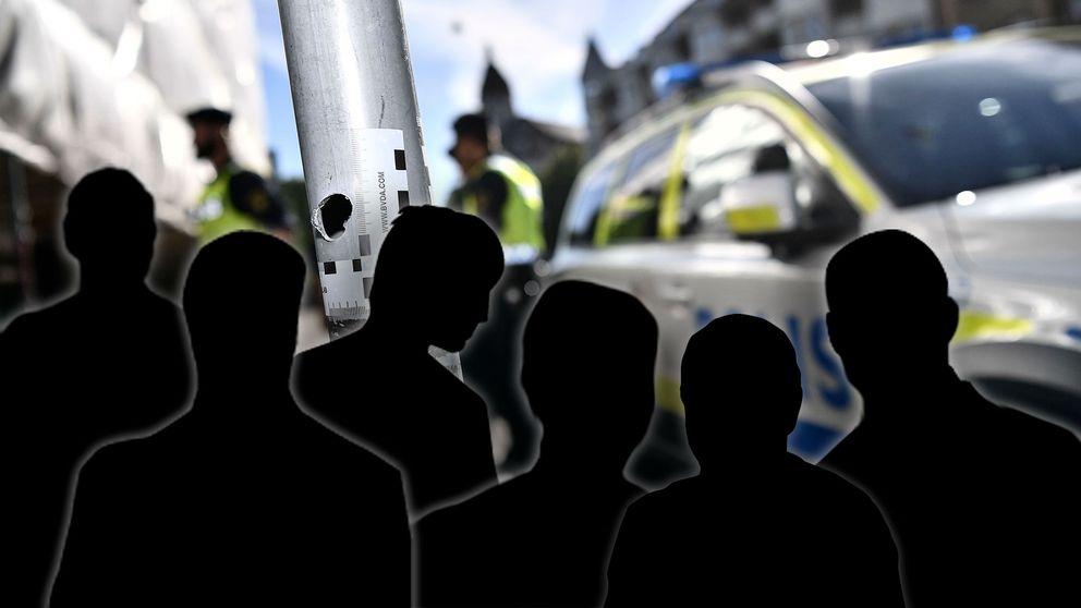 Sex anonyma silhuetter framför poliser i Malmö