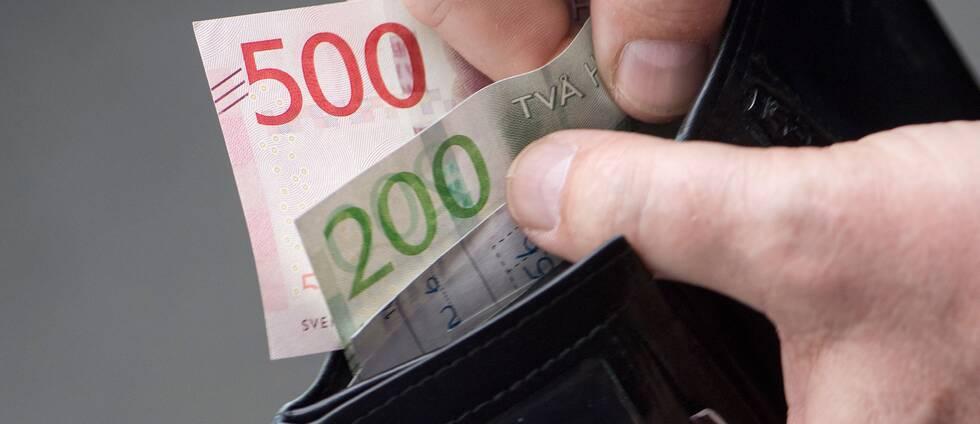 Plånbok med sedlar.