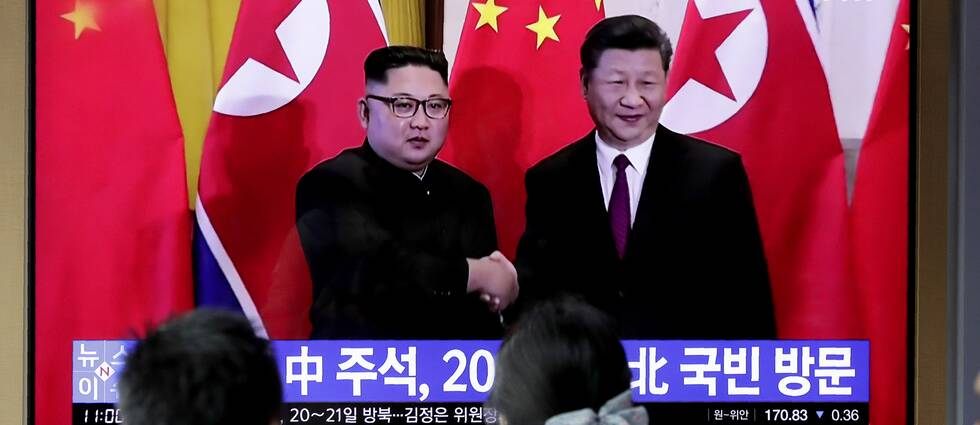 Kinas president Xi Jinping och Nordkoreas ledare Kim Jong-Un.