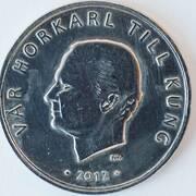 Den falska enkronan som smädar kung Carl XVI Gustaf. Foto: Scanpix