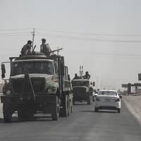 Kurdiska Peshmerga lämnar staden Kirkuk, staden faller till irakiska armen som tar kontroll.