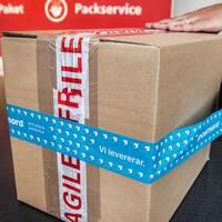 Ömtåligt paket som skickas med Postnord.