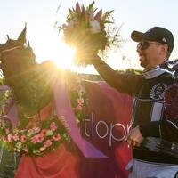 Trainer Daniel Redén of Sweden and horse Propulsion celebrate after winning the Elitloppet final trotting race on May 31, 2020 in Stockholm.