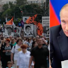 Ryska oppositionella bär plakat med bilder på politiska fångar under en demonstration i Moskva 2013.