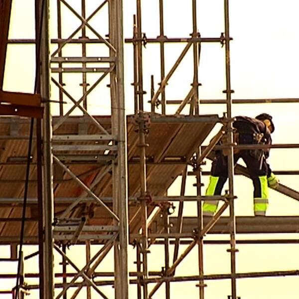 Byggjobbare på byggnadsställning