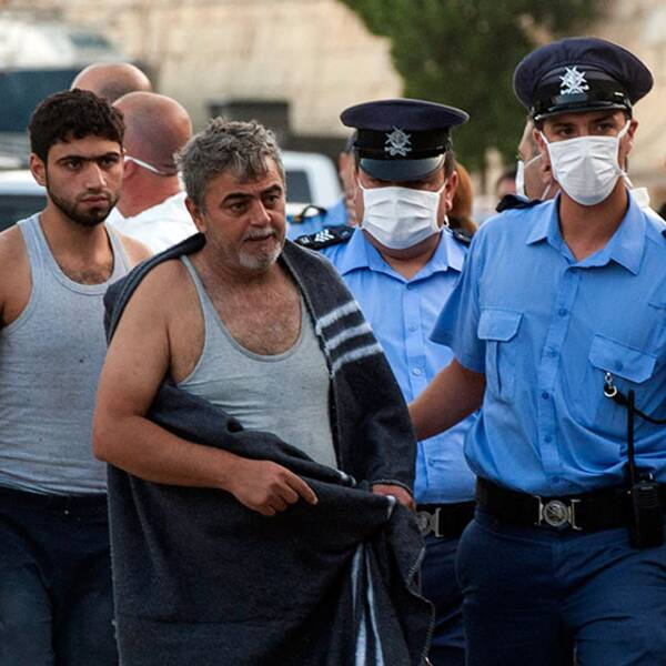 Två män räddas från den träbåt full med immigranter som kapsejsade utanför Malta på fredagen.
