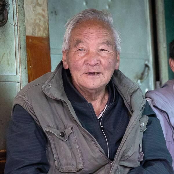 Cong Li är före detta jordbrukare och har sett klimatförändringarnas påverkan på nära håll.