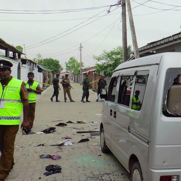 Polis och soldater i Kalmunai efter räden mot den misstänkta terroristgömman.