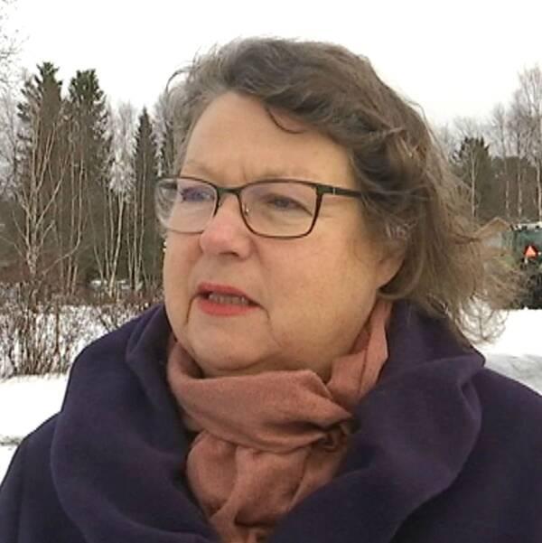 Skylt med texten Region Jämtland Härjedalen. Bild på brunhårig kvinna med glasögon