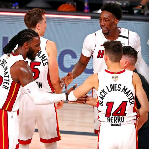 Miami jublar och LeBron James deppar efter nattens femte NBA-final som Heat vann.