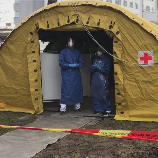 en kvinna med brunt hår poch glasögon och ett tält under coronapandemin vid falulasarett
