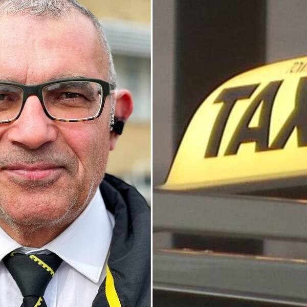 En man med glasögon och öronsnäcka i taxiuniform, med en taxibil i bakgrunden.