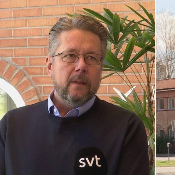 Mats-Erik Olofsson vd på Borlänge Energi vid en skylt där det står Borlänge Energi. Mats-Erik Olofsson har en blå skjorta med en svart tröja över. Han bär glasögon.