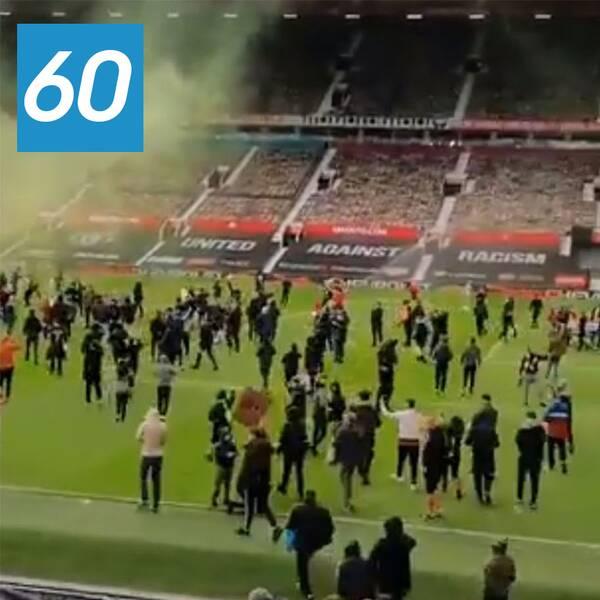 Manchester United-supportrar tog sig in på planen inför stormötet