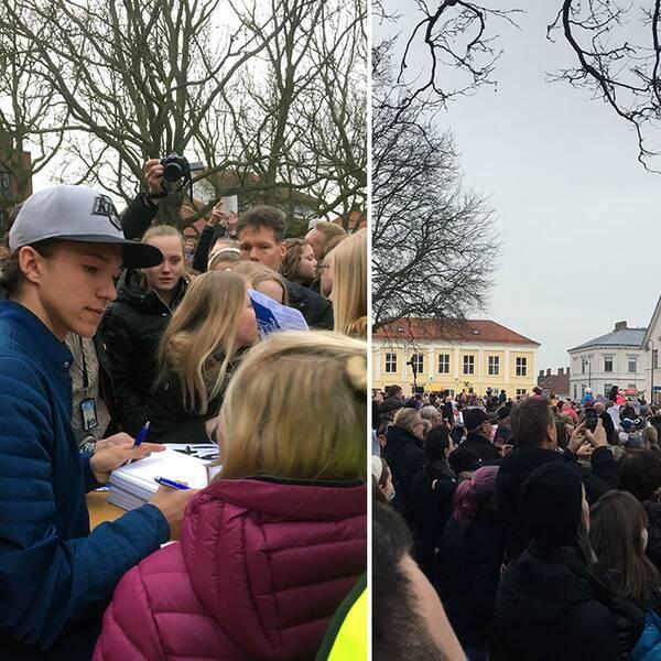 Frans skriver autografer till fansen.