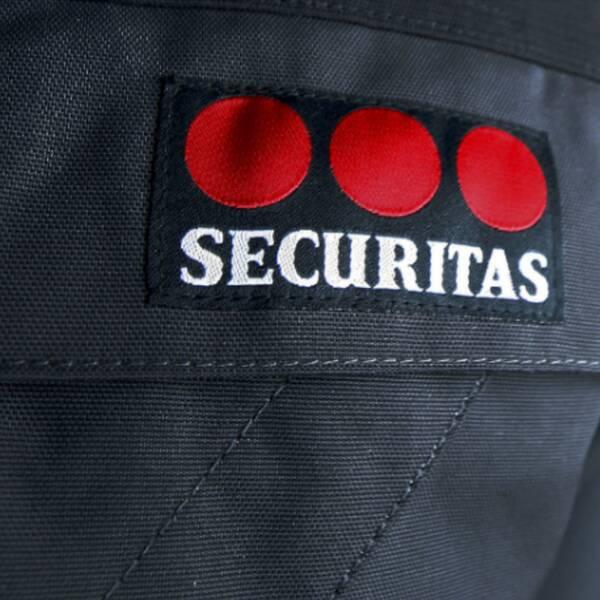 securitas logga och pengar