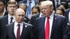 Vladimir Putin (till vänster) och Donald Trump vid ett tidigare möte.