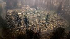 Bostadsområde i Paradise jämnat till marken av bränderna. Siffran för saknade har överstigit 1000 personer.