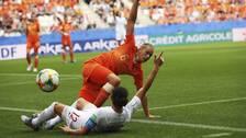 Nederländerna och Kanada under sista gruppspelsmatchen.