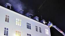 En okänd person misstänks ha anlagt branden som orsakade skador på en lägenhet och två personer som fördes till sjukhus.