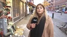 reporter framvör gravljus och blommor