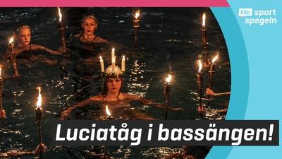 Konstsimmarna bjöd på Luciatåg i bassängen!